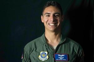 Airman poses wearing flight suit.