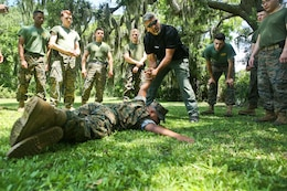 Howard Shappey demonstrates subduing techniques as part of Security Augmentaion Force training aboard Marine Corps Recruit Depot Parris Island May 23. SAF is a detail of Marines selected to assist the Provost Marshal's Office with security in emergency situations. Shappey is a training specialist with PMO.