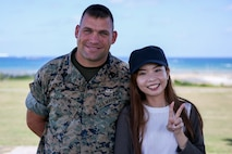 Gunnery Sgt. Scott Michael Dahn, left, and Ching-Yi Sze, left, come together after Dahn rescued Ching-Yi while scuba diving May 20, 2018 at Maeda Point, Okinawa, Japan. Dahn brought Ching Yi, a Hong Kong native, to safety after she nearly drowned while scuba diving and supplied oxygen and care to her until paramedics came. Dahn, a native of Herron, Michigan, is the training chief for 3rd Maintenance Battalion, 3rd Marine Logistics Group, III Marine Expeditionary Force.