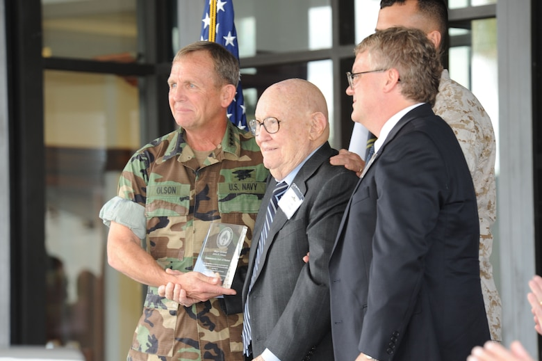 Adm. Eric T. Olson, commander of U.S. Special Operations Command, officially inducts retired Maj. Gen John R. Alison into the SOCOM Commando Hall of Honor at a ceremony Oct. 27, MacDill Air Force Base, Fla.