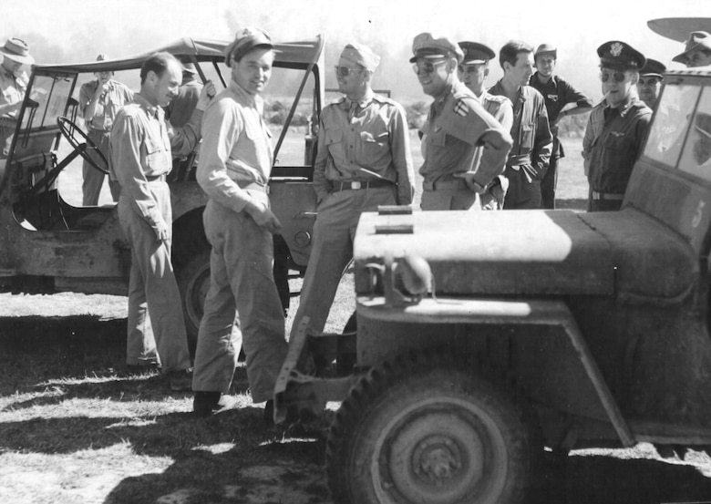 "Col. John R. Alison, Col. Philip Cochran and Brig. Gen. William D. Old, commanding general of the Troop Carrier Commando, await ""D-Day"" take off of the 1st Air Commando Force gliders at Lalaghat, India. (Historical photo)"