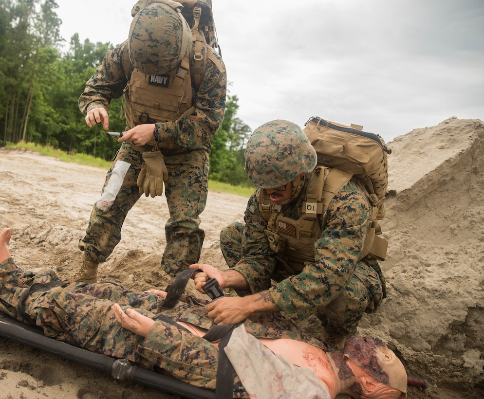Petty Officer 3rd Class Emilie Evans, hospital corpsman, 22nd Marine Expeditionary Unit, directs the placement of a simulated casualty during the Tactical Evacuation Course at Camp Lejeune, N.C., May 23, 2018. The Tactical Evacuation Course trained hospital corpsman the proper techniques to use in unusual evacuation environments.  (U.S. Marine Corps photo by Lance Cpl. Tawanya Norwood)