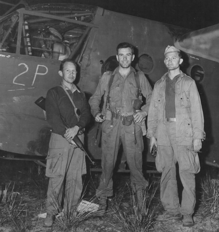 (L to R) Col. Johnny Cochran, and unknown British Chindit commando, and Maj. William H. Taylor on landing zone Broadway in Burma during Operation THURSDAY.