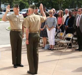 Brig. Gen. Eric. E. Austin, Deputy Commander, U.S. Marine Corps Forces Command, was frocked by Lt. Gen. Mark A. Brilakis, Commander, MARFORCOM, at a promotion ceremony at MARFORCOM headquarters, Naval Support Activity Hampton Roads, Va., May 23. The frocking ceremony, a Naval tradition dating back to 1802, was attended by family, friends and service members from near and far.