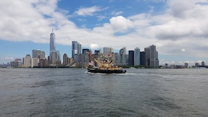 DCV Hayward transits New York Harbor with Lower Manhattan in the background