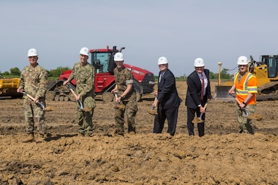 Honored guests participate in the groundbreaking of a brand new Reserve Training Center in Des Moines, Iowa, May 24, 2018. The construction of the new joint Navy and Marine Corps Reserve Training Center hosting Company E, 2nd Battalion, 24th Marines, 23rd Marine Regiment, 4th Marine Division, and the Navy Operational Support Center in Des Moines, Iowa, May 24, 2018.