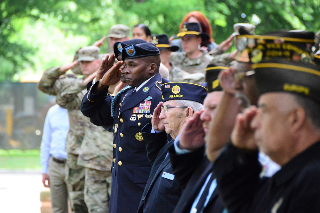 Soldiers, civilians and retirees are joined by local members of the American Legion to pay tribute to fallen service members.