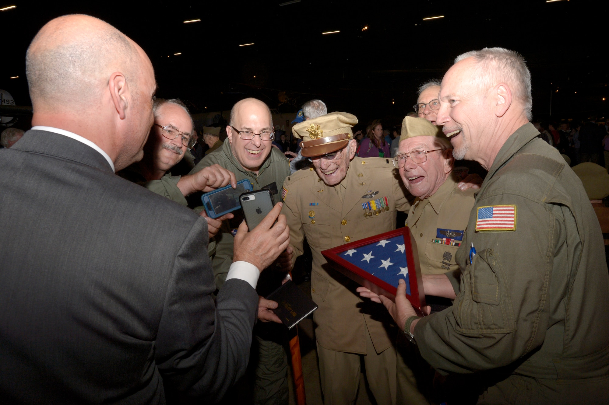 The Cincinnati Warbirds Experimental Aircraft Association Squadron 18 presented a U.S. flag to Herb Heilbrun, a 97-year-old B-17 pilot veteran. The flag was flown on the B-17 Yankee Lady during the formation flyover at the U.S. Air Force Museum, May 16, 2018. (U.S. Air Force photo by Staff Sgt. Megan Friedl)