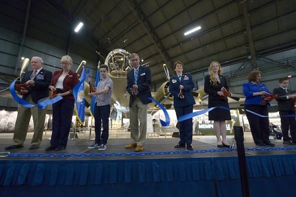 Special guests including National Museum of the U.S. Air Force Director retired Lt. Gen. John L. Hudson and Air Force Director of Staff Lt. Gen. Jacqueline D. Van Ovost cut the ceremonial ribbon for the public opening of the Memphis Belle at the National Museum of the U.S. Air Force, Ohio, May 17, 2018. The Memphis Belle crew completed their 25th mission in Europe exactly 75 years before the ribbon cutting ceremony. (U.S. Air Force photo by Staff Sgt. Megan Friedl)