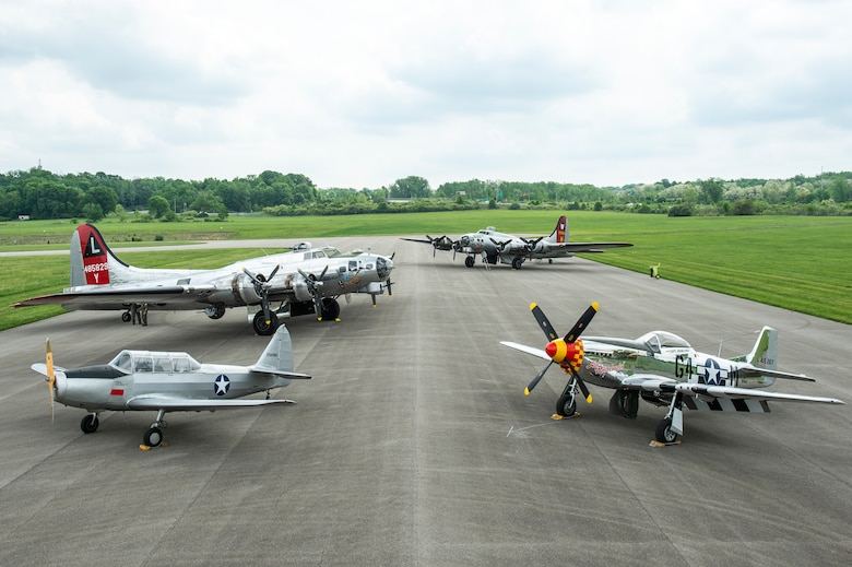 The Aluminum Overcast and Yankee Lady, both B-17s, along with the P-51 Ain't Misbehavin' and a Heritage trainer are displayed at the National Museum of the U.S. Air Force flight line May 17, 2018. They performed a flyover over the museum during the morning to commemorate the opening of the Memphis Belle. (U.S. Air Force photo by Staff Sgt. Megan Friedl)