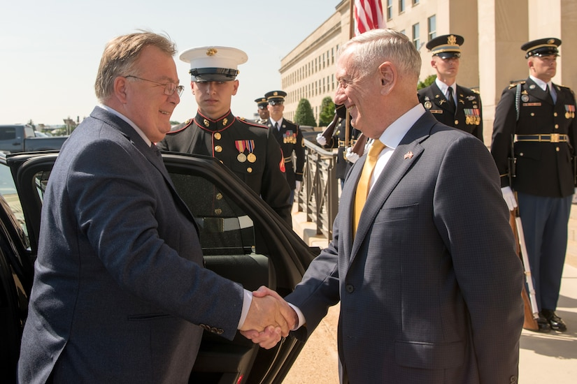 Defense Secretary James N. Mattis shakes hands with a person.