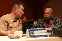 Brig. Gen. Kim Taesung, left, chief of staff, Republic of Korea Marine Corps and Rear Adm. Udeni Indranatha Serasinghe, Director General land Operation and Director, Sri Lanka Navy Infantry and Navy Marine, speak during the Pacific Amphibious Leaders Symposium (PALS) in Honolulu, Hawaii, May 21-24, 2018.