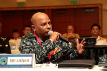 Sri Lankan Navy Rear Adm. Udeni Indranatha Serasinghe, Director General land Operation and Director, Sri Lanka Navy Infantry and Navy Marine, asks a question during the Pacific Amphibious Leaders Symposium (PALS) in Honolulu, Hawaii, May 24, 2018.
