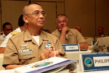 Maj. Gen. Alvin Parreño, commandant of the Philippine Marine Corps claps at the closing of the Pacific Amphibious Leaders Symposium (PALS) in Honolulu, Hawaii, May 24, 2018.