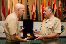 U.S. Marine Lt. Gen. David H. Berger, commander, U.S. Marine Corps Forces, Pacific, receives a gift from Peruvian Vice Admiral Fernando Cerdan, commander, Pacific Operations General Command, during the Pacific Amphibious Leaders Symposium (PALS) 2018 held in Honolulu, Hawaii, May 21-24, 2018.