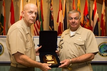 Peruvian Vice Admiral Fernando Cerdan, commander, Pacific Operations General Command, gives a gift to U.S. Marine Corps Lt. Gen. David H. Berger, commander, U.S. Marine Corps Forces, Pacific, during the Pacific Amphibious Leaders Symposium (PALS) 2018 in Honolulu, Hawaii, May 24, 2018.
