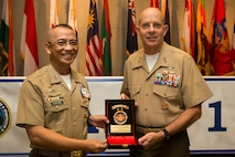 Philippine Marine Corps Maj. Gen. Alvin A. Parreno, commandant, Philippine Marine Corps, gives a gift to U.S. Marine Corps Lt. Gen. David H. Berger, commander, U.S. Marine Corps Forces, Pacific, during the Pacific Amphibious Leaders Symposium (PALS) 2018 in Honolulu, Hawaii, May 24, 2018.