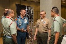 Malaysian Col. Loc Hamaca Hj Nawi, left, commanding officer, 21st CDO; Indonesian Marine Corps Brig. Gen. Nur Alamsyah, commander, 2nd Marine Forces; Philippine Marine Corps Maj. Gen. Alvin A. Parreno, commandant, Philippine Marine Corps; and Malaysian Brig. Gen. Tengku Muhammad Fauzi Tengku Ibrahim, commander, 10th Brigade, have a discussion during the Pacific Amphibious Leaders Symposium (PALS) 2018 in Honolulu, Hawaii, May 21-24, 2018.