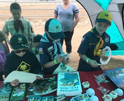 "Boy Scouts check out ""Bobber the Safety Dog"" materials and other U.S. Army Corps of Engineers information during a May 12 community tree-planting event in Norco, California."
