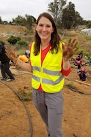 Sheri Shiflett, biologist with the Los Angeles District's Environmental Resources Branch Planning Division, proves even biologists get their hands dirty during a May 12 tree-planting event in Norco, California.