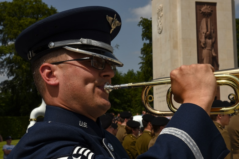 A U.S. Air Force service member preforms Taps after an observed moment of silence during the Memorial Day Ceremony at Luxembourg American Military Cemetery in Hamm, Luxembourg, May 26, 2018. Taps is a bugle call typically played at dusk, during flag ceremonies and military funerals to honor fallen members of the U.S. Armed Forces. (U.S. Air Force photo by Senior Airman Dawn M. Weber)