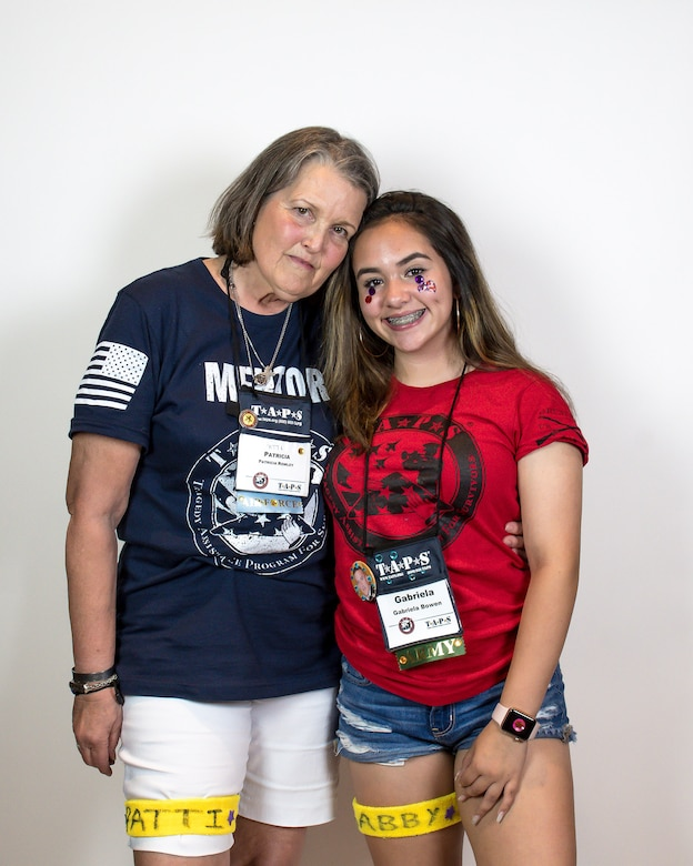 Patti Rowley, mentor, poses with her mentee, Gabby Bowen during the Tragedy Assistance Program for Survivor's 24th annual National Military Survivor Seminar and Good Grief Camp in Arlington, Virginia.
