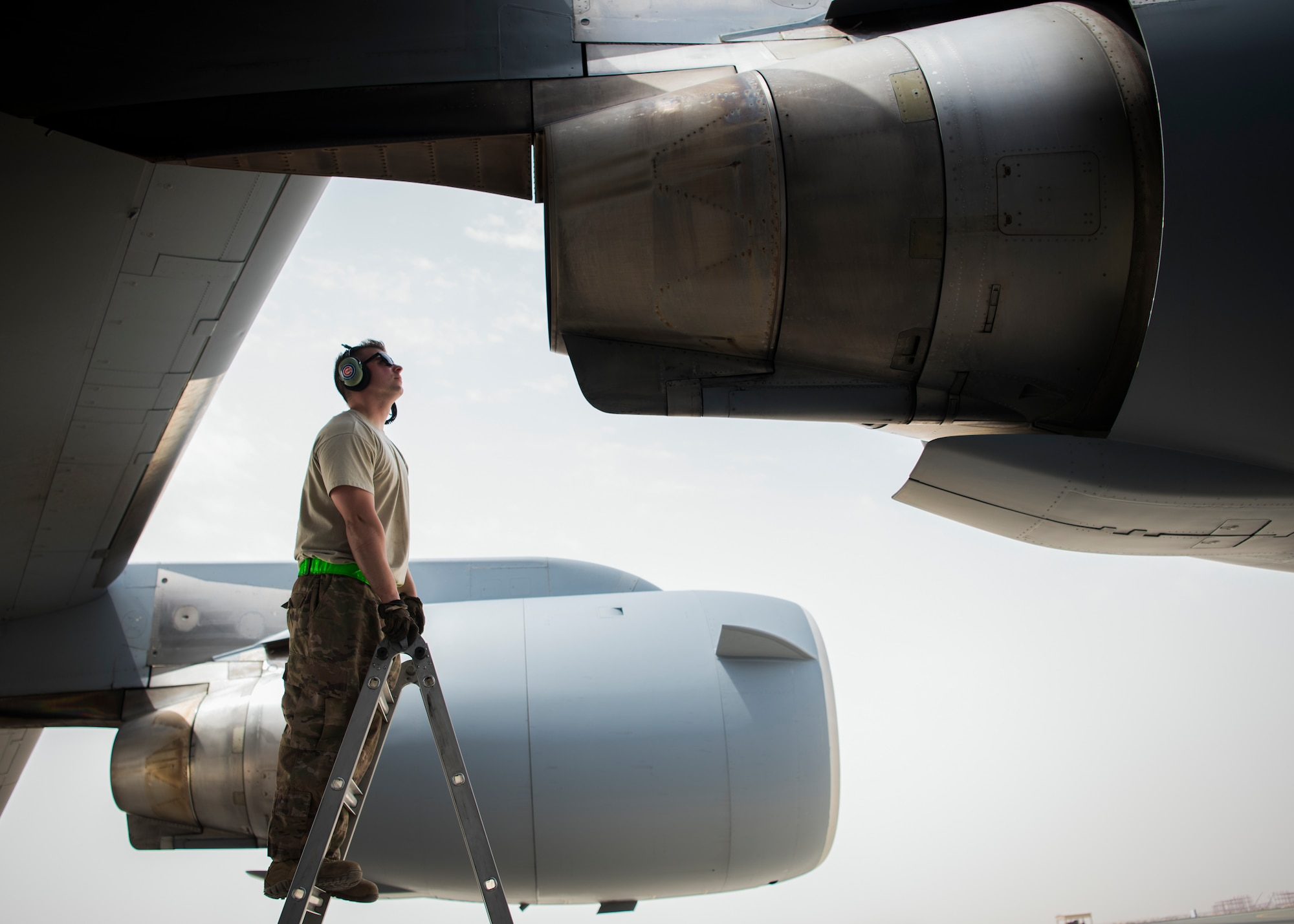 Senior Airman Eric Pashnick, 5th Expeditionary Air Mobility Squadron crew chief, inspects an engine on a C-17 Globemaster III aircraft May 23, 2018, at an undisclosed location in Southwest Asia. The primary mission of the C-17 here is to provide rapid strategic delivery of troops and various types of cargo to bases throughout the U.S. Central Command area of responsibility. (U.S. Air Force photo by Staff Sgt. Christopher Stoltz)