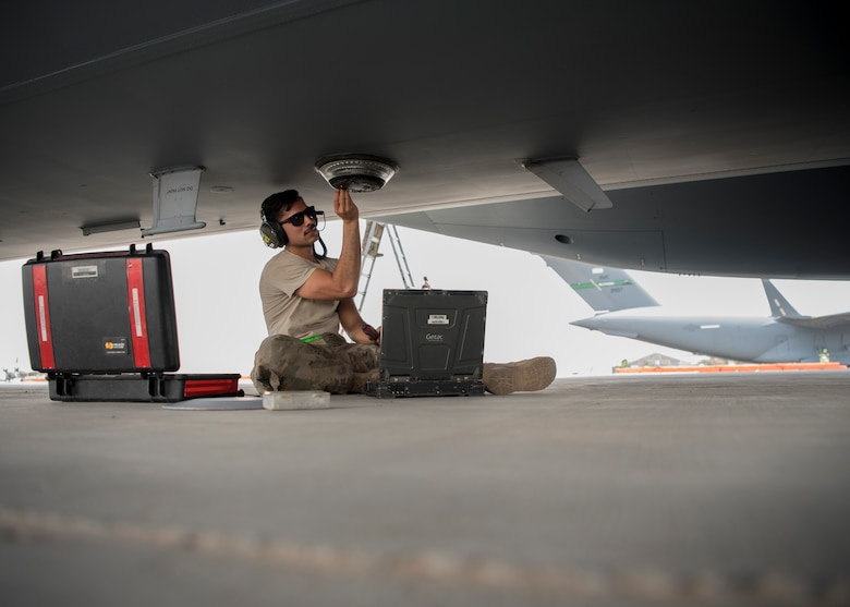 Senior Airman John Acevedo, 5th Expeditionary Air Mobility Squadron maintainer, inspects an instrument on a C-17 Globemaster III aircraft May 23, 2018, at an undisclosed location in Southwest Asia. As a tenant unit under the 386th Air Expeditionary Wing, the 5th EAMS maintains staged C-17 Globemaster III aircraft in addition to providing support for transient aircraft flying in and out of Iraq, Afghanistan and other countries in Southwest Asia. (U.S. Air Force photo by Staff Sgt. Christopher Stoltz)