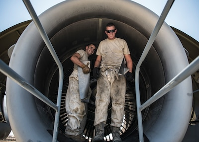 Senior Airman Cory Woodford, 5th Expeditionary Air Mobility Squadron aerospace propulsion journeyman and Senior Airman Clayton Cahoon, 5th EAMS crew chief, replace rotor blades on a C-17 Globemaster III aircraft May 17, 2018, at an undisclosed location in Southwest Asia. The primary mission of the C-17 here is to provide rapid strategic delivery of troops and various types of cargo to bases throughout the U.S. Central Command area of responsibility. (U.S. Air Force photo by Staff Sgt. Christopher Stoltz)