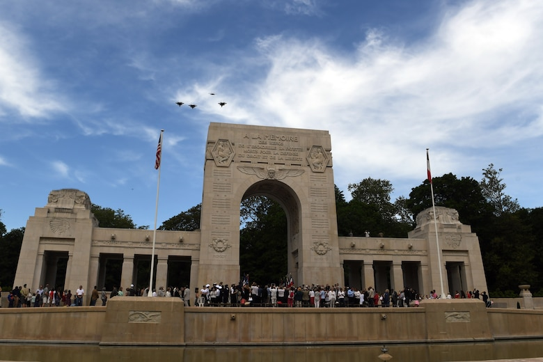 Four F-15 fighters fly in formation over the Lafayette Escadrille Memorial.