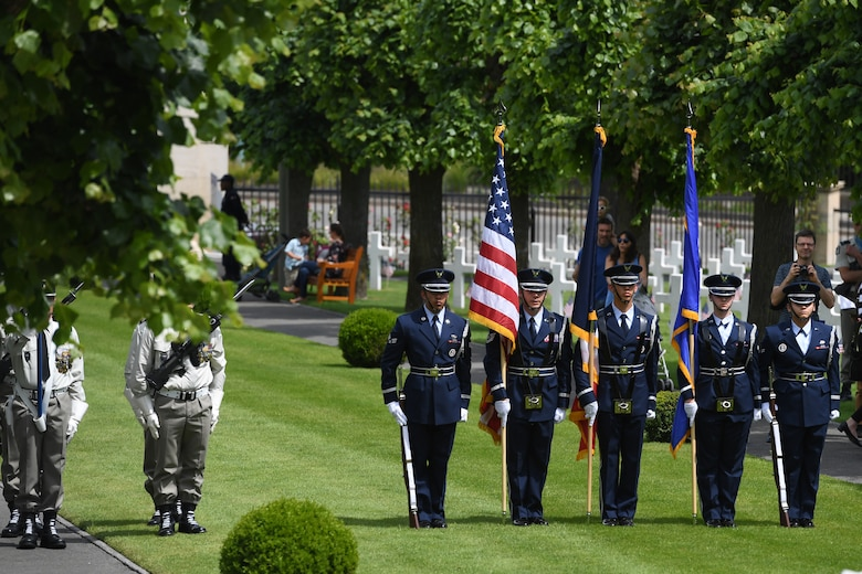 An honor guard detail from Spangdahlem Air Base, Germany, participates in a Memorial Day ceremony alongside their French counterparts at Suresnes American Cemetery.