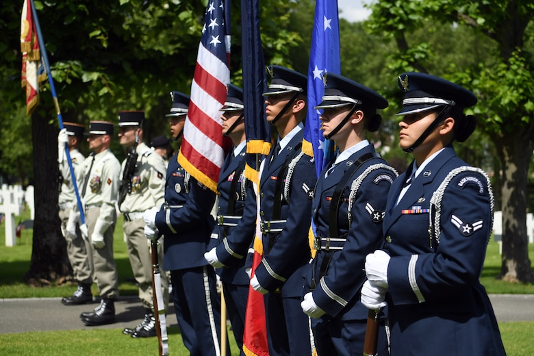 An honor guard detail from Spangdahlem Air Base, Germany, participates in a Memorial Day ceremony alongside their French counterparts at Suresnes American Cemetery and Memorial.