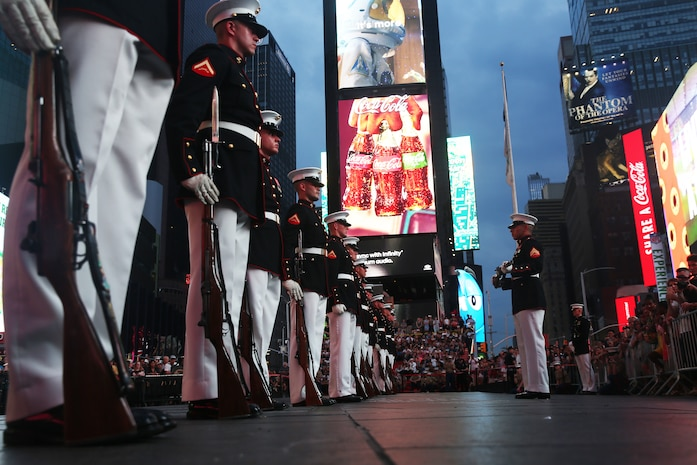 U.S. Marines with the United States Marine Corps Silent Drill Platoon, Battle Color Detachment, Marine Barracks Washington, D.C., perform precision rifle drill movements for the crowds during a USMC Battle Colors Detachment Performance during Fleet Week New York in Times Square, New York, May 26, 2018. Now in its 30th year, Fleet Week is the city's time-honored celebration of the sea services. It is an unparalleled opportunity for the citizens of New York and the surrounding tri-state area to meet Marines, Sailors, and Coast Guardsmen, as well as witness firsthand the latest capabilities of today's maritime services.