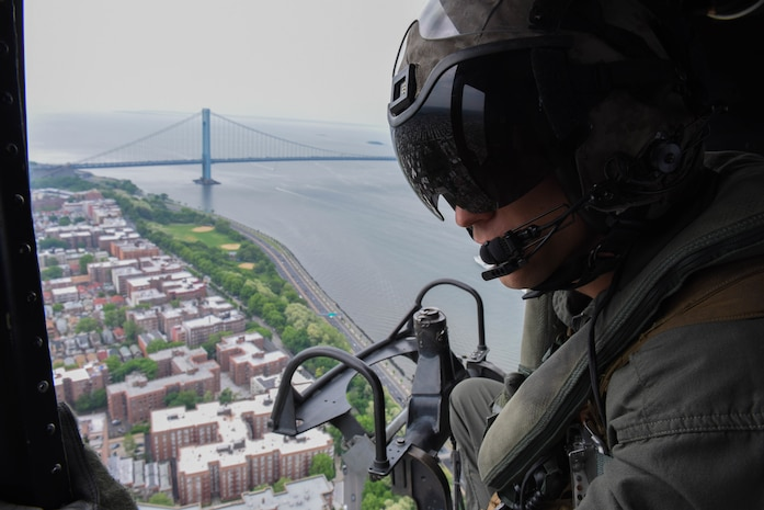 Staff Sgt. Raymond Brown, with Special Purpose Marine Air-Ground Task Force Fleet Week New York, watches the Manhattan Bridge and New York pass below on a flight to Marine Day at Prospect Park in Brooklyn, New York, May 26. Now in its 30th year, Fleet Week is the city's time-honored celebration of the sea services. It is an unparalleled opportunity for the citizens of New York and the surrounding tri-state area to meet Marines, Sailors, and Coast Guardsmen, as well as witness firsthand the latest capabilities of today's maritime services.
