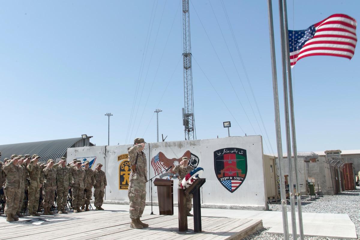 An Air Force officer salutes a wreath.