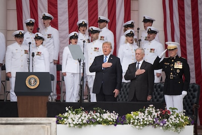 President Donald J. Trump, Defense Secretary James N. Mattis, and Marine Corps Gen. Joe Dunford, chairman of the Joint Chiefs of Staff, render honors during the 150th National Memorial Day Observance at Arlington National Cemetery, Va.
