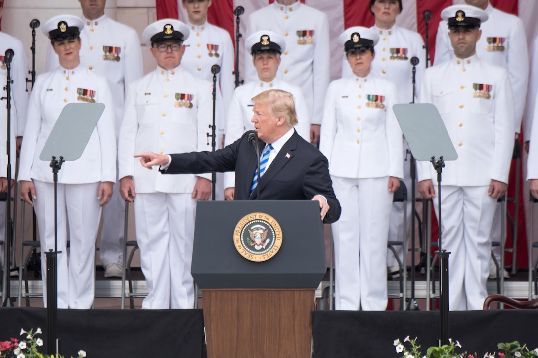 The president speaks from a stage.