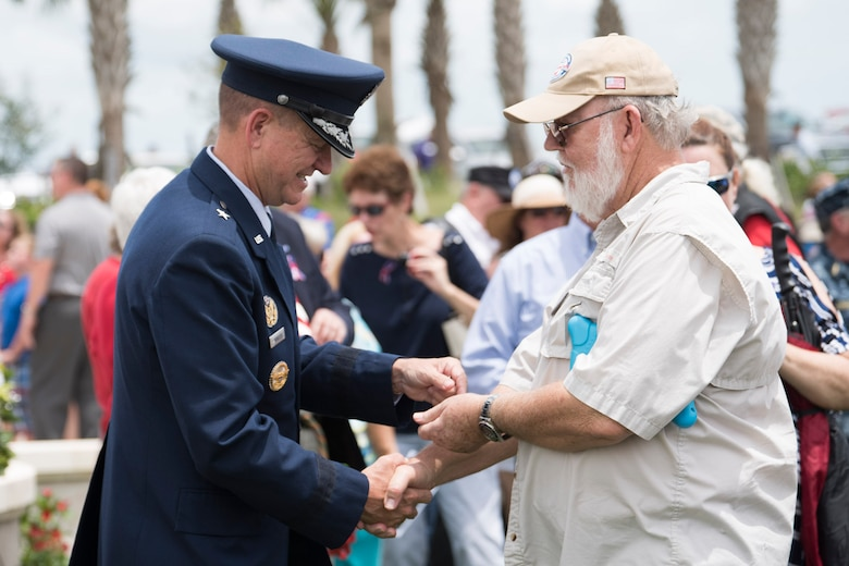 Brig. Gen. Wayne Monteith, Commander of the 45th Space Wing, gives a Vietnam War 50th anniversary pin to a Vietnam veteran, May 28, 2018. Each Vietnam veteran that had not yet received a pin came down to the front and received one from Brig. Gen. Monteith or Retired Chief Weather Officer Frank Anton. (U.S. Air Force photo by Airman 1st Class Dalton Williams)