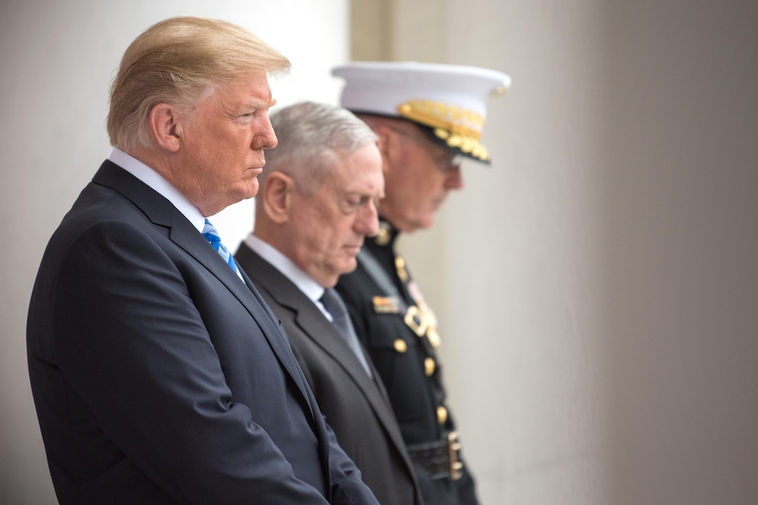 The president, defense secretary and chairman of the Joint Chiefs of Staff stand in a row.