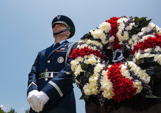 A Kadena Air Base honor guardsman stands next to a wreath during a Memorial Day ceremony May 25, 2018, at Kadena Air Base, Japan. Members of Team Kadena gathered to remember and honor U.S. service members who paid the ultimate sacrifice for their country. (U.S. Air Force photo by Staff Sgt. Micaiah Anthony)