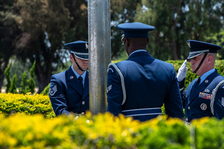 Kadena Air Base honor guardsmen post the American flag at half-staff during a Memorial Day ceremony May 25, 2018, at Kadena Air Base, Japan. The American flag was posted at half-staff to honor U.S. service members who gave their lives in support of their country. (U.S. Air Force photo by Staff Sgt. Micaiah Anthony)