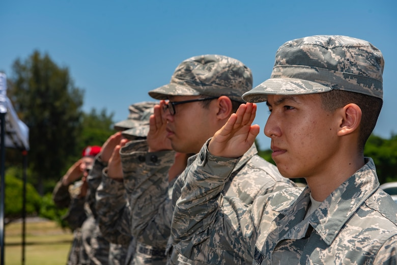 U.S. Air Force Airmen salute during a Memorial Day ceremony May 25, 2018, at Kadena Air Base, Japan. Each year Memorial Day is held the last Monday of May to honor U.S. service members who paid the ultimate sacrifice for their country. (U.S. Air Force photo by Staff Sgt. Micaiah Anthony)
