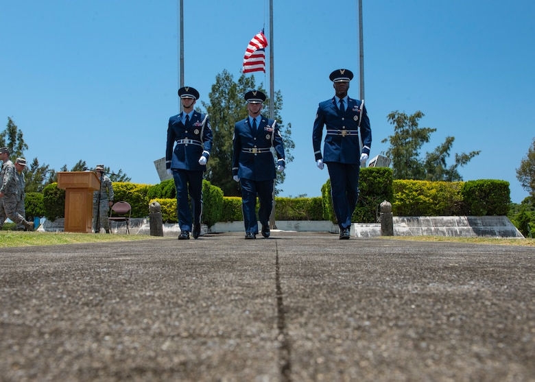 Kadena Air Base honor guardsmen march after posting the American flag at half-staff during a Memorial Day ceremony May 25, 2018, at Kadena Air Base, Japan. The American flag was posted at half-staff to honor U.S. service members who gave their lives in support of their country. (U.S. Air Force photo by Staff Sgt. Micaiah Anthony)