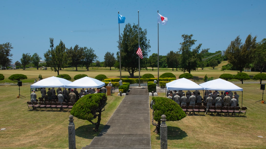 Members of Team Kadena honor the fallen during a Memorial Day ceremony May 25, 2018, at Kadena Air Base, Japan. Each year Memorial Day is held the last Monday of May to honor U.S. service members who paid the ultimate sacrifice for their country. (U.S. Air Force photo by Staff Sgt. Micaiah Anthony)