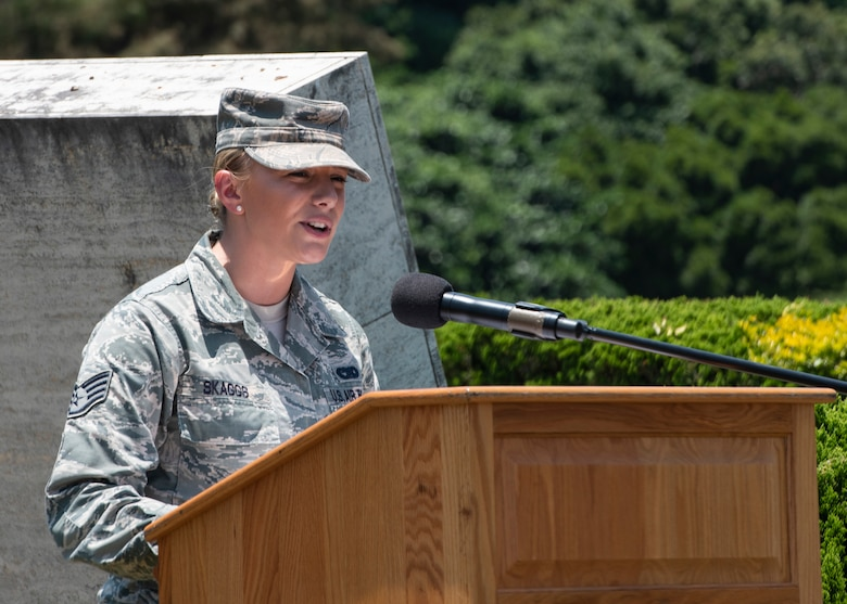 U.S. Air Force Staff Sgt. Chelsea Skaggs, 18th Logistics Readiness Squadron Travel Management Office passenger travel supervisor, gives open remarks during a Memorial Day ceremony May 25, 2018, at Kadena Air Base, Japan. Members of Team Kadena gathered to remember and honor U.S. service members who paid the ultimate sacrifice for their country. (U.S. Air Force photo by Staff Sgt. Micaiah Anthony)
