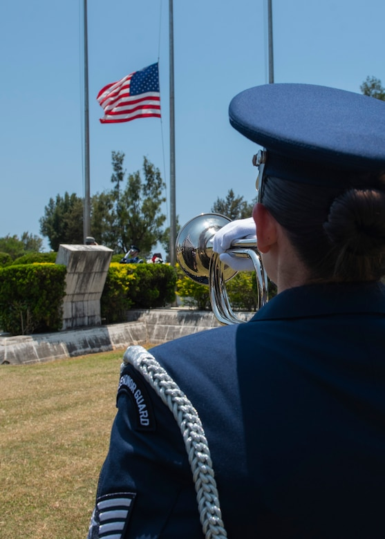 A Kadena Air Base honor guardsman holds a bugle in place as the bugle plays Taps during a Memorial Day ceremony May 25, 2018, at Kadena Air Base, Japan. Members of Team Kadena gathered to remember and honor U.S. service members who paid the ultimate sacrifice for their country. (U.S. Air Force photo by Staff Sgt. Micaiah Anthony)