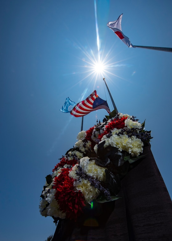 A wreath honoring the fallen sits at the base of an American flag after a Memorial Day ceremony May 25, 2018, at Kadena Air Base, Japan. Each year Memorial Day is held the last Monday of May to honor U.S. service members who paid the ultimate sacrifice for their country. (U.S. Air Force photo by Staff Sgt. Micaiah Anthony)