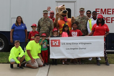 "Maj. Scotty Autin, deputy district commander for the U.S. Army Corps of Engineers Los Angeles District. ""Yes we are ready to have fun,"" shouted the group of LA District team members and their families assembled and ready to walk in the two-mile parade route May 19 as participants in the 59th annual City of Torrance Armed Forces Day parade."