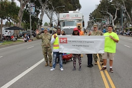 Maj. Scotty Autin, deputy district commander for the U.S. Army Corps of Engineers Los Angeles District and Lt. Col. Peter Stambersky, Los Angeles District contracting officergroup of LA D joined district team members and their families assembled for the two-mile parade route May 19 as participants in the 59th annual City of Torrance Armed Forces Day parade.