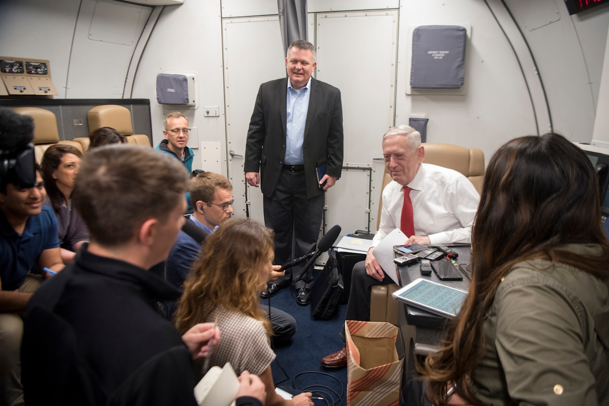 Defense Secretary James N. Mattis speaks with reporters on a plane.